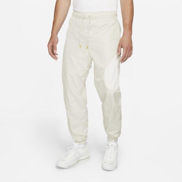 Nike Sportswear Swoosh Pantalón de tejido Woven con forro - Hombre - Gris